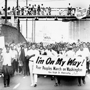 Sign-carrying participants in the southern leg of the Poor People's Campaign march through Atlanta, May 10, 1968. The group goes to middle Georgia as the next step in the march toward Washington. (AP Photo)