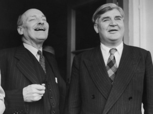 British politicians Clement Attlee (1883 - 1967, left) and Aneurin Bevan (1897 - 1960) leaving London Airport (now Heathrow) on the first stage of their journey to China, 9th August 1954. They are part of a Labour Party delegation visiting China, the first official party from the West to visit the People's Republic. (Photo by Meager/Fox Photos/Hulton Archive/Getty Images)